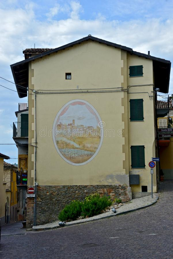 Historical building in Neive with a painting on the wall. View of historical building in Neive with a painting on the wall stock photo