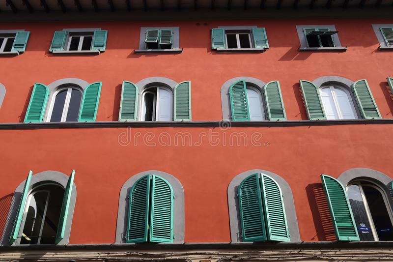 Historical building in Pisa, Italy. Facade of a historical building with shutters in Pisa, Italy royalty free stock photos