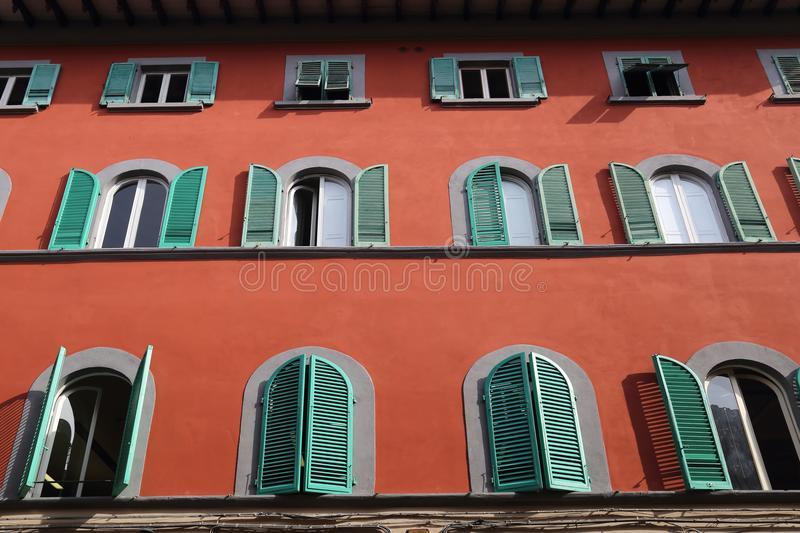 Historical building in Pisa, Italy. Facade of a historical building with shutters in Pisa, Italy stock image