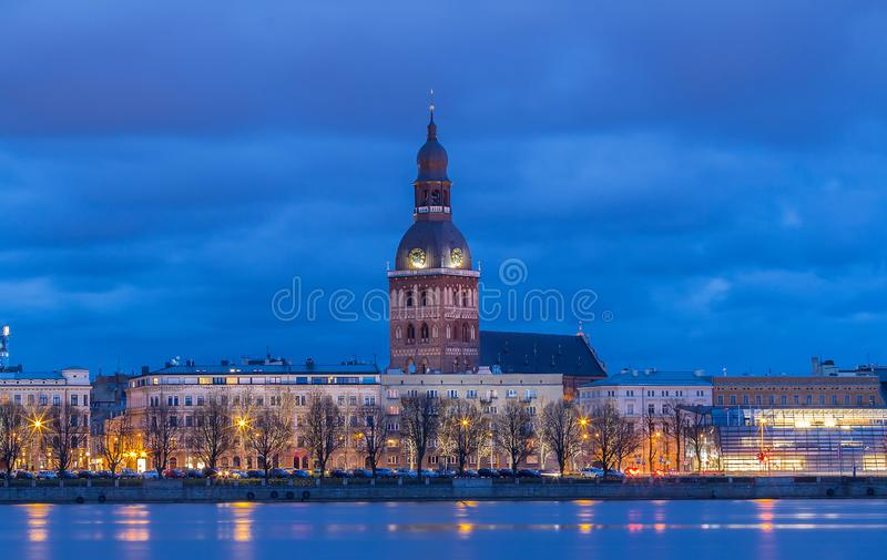 Historical building of Riga Dome Cathedral and Daugava river at night , Latvia. Historical building of Riga Dome Cathedral and Daugava river in the evening royalty free stock photos