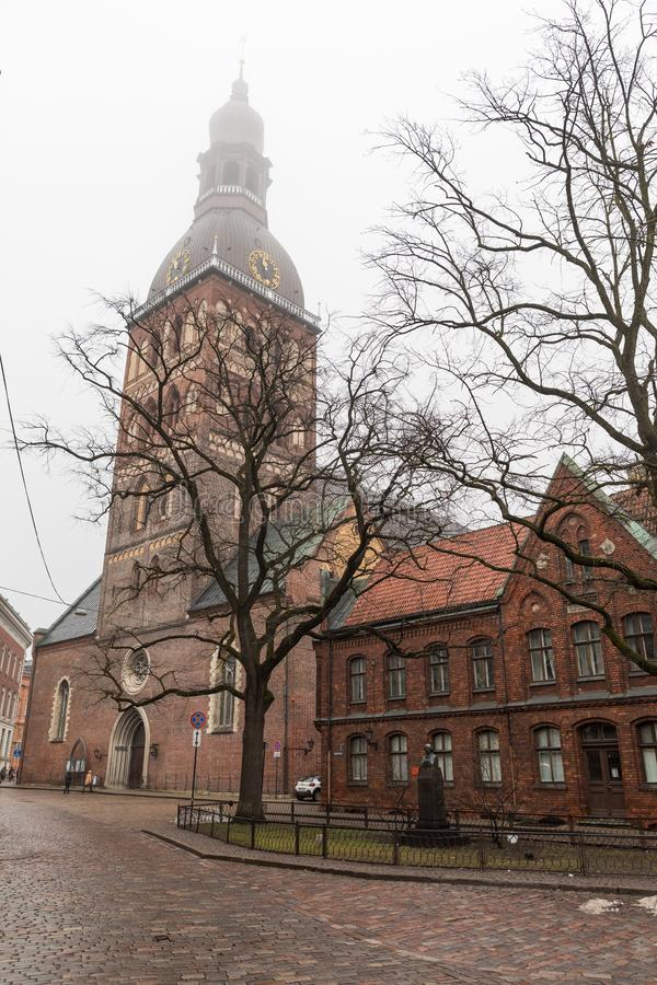 Historical building of Riga Dome Cathedral, Latvia. In winter with fog in the sky stock images