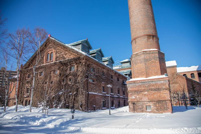 Historical Building of Sapporo Beer Museum in winter, snowy day. 19 jan 2019 - Sapporo, Japan: Historical Building of Sapporo Beer Museum in winter, snowy day stock photos