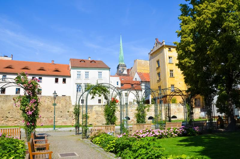 Historical buildings in city center with Cathedral of St. Bartholomew photographed from adjacent green park in Krizikovy sady,. Pilsen, Czech Republic. Plzen stock image