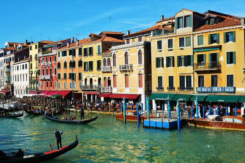 Historical buildings and gondolas from Rialto bridge, Venice, Italy, Europe. Romantic cityscape, gondolas, restaurants and historical buildings on Grand Canal royalty free stock images
