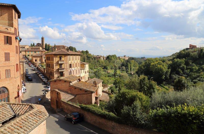 Historical buildings in old Siena in Tuscany, Italy. Historical buildings and green gardens in old Siena in Tuscany, Italy stock photography