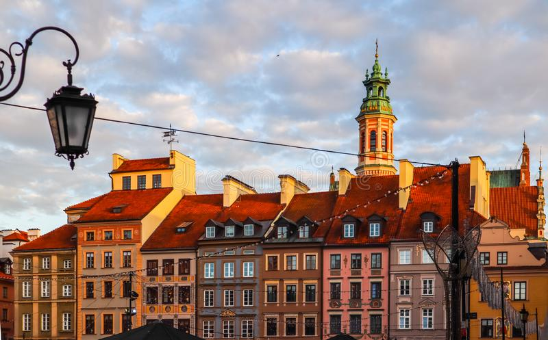 Historical buildings at Market Square of the Old Town with Christmas decorations in sunset. Warsaw, Poland.  royalty free stock photos