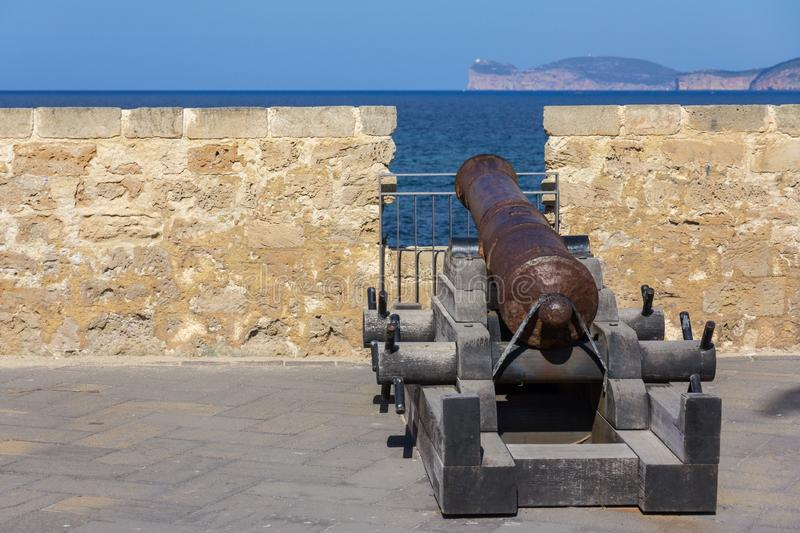 Historical cannon in old town of Alghero, Sardinia island, Italy stock images