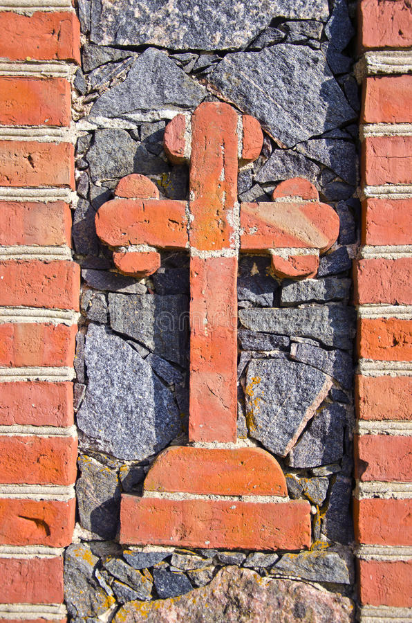 Historical cemetery gate  bricks cross
