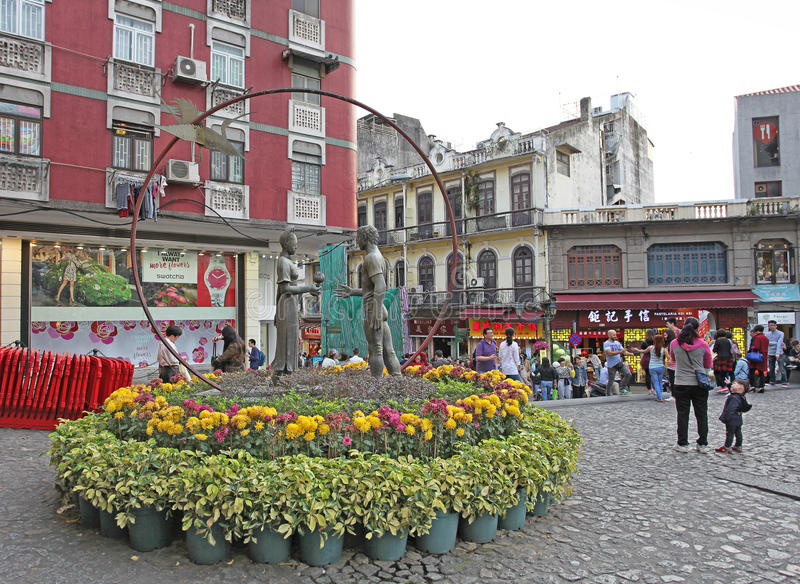 Historical center of Macau with statue of lovers. Historical center of Macau with s.ulpture of locers. March 2016 stock images