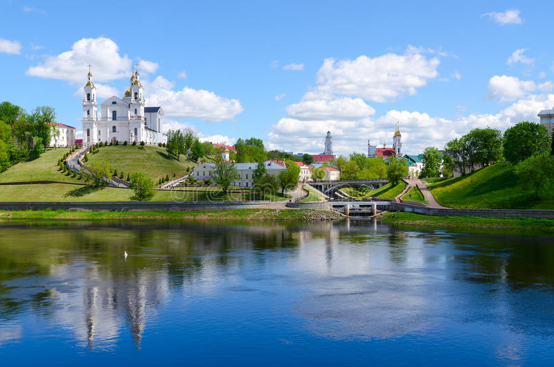 Historical center of Vitebsk over Western Dvina, Belarus. Beautiful view of historical center of Vitebsk over Western Dvina, Belarus. Holy Dormition Cathedral stock images