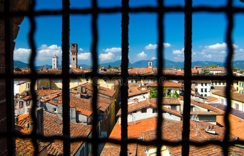 Historical centre of medieval town Lucca with old buildings, typical orange terracotta tiled roofs royalty free stock photos
