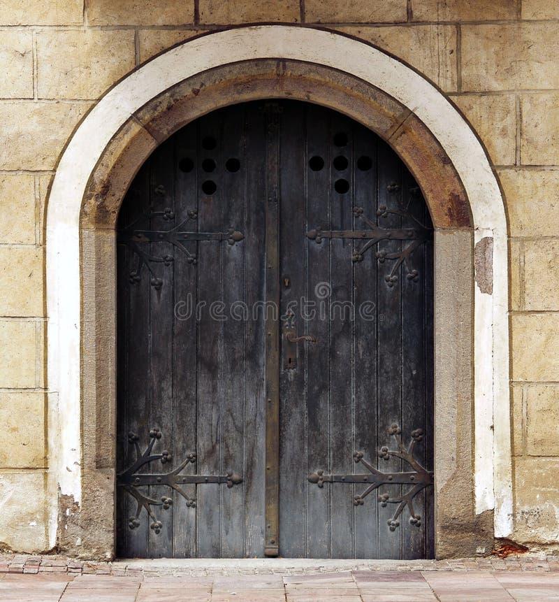 Historical door. Concept of historical wooden door royalty free stock photo