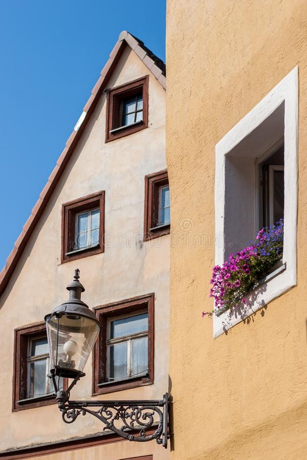 Historical facade with flowers and lantern- Bayreuth old town stock photography