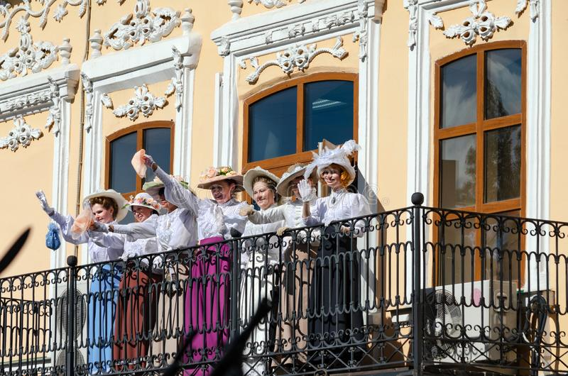 Historical festival Shadrinsk city, Russia June 25, 2017. Ladies waving handkerchiefs from the balcony, past the bottom are stock photos