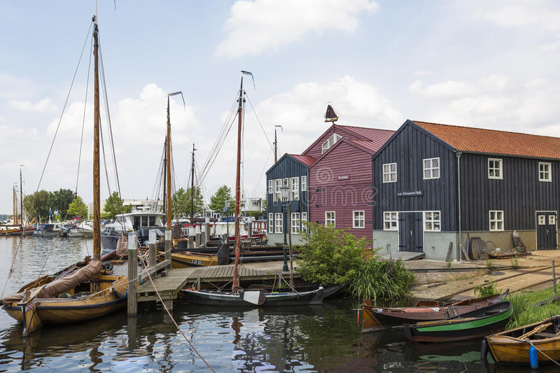 Historical fishing boats in Netherlands harbor Elburg