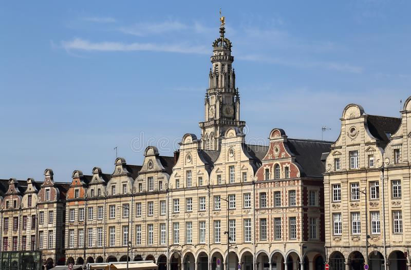 Historical houses on Grand Place in Arras, France. Historical gables of houses and tower of the cathedral on the Grand Place in Arras, France royalty free stock photography