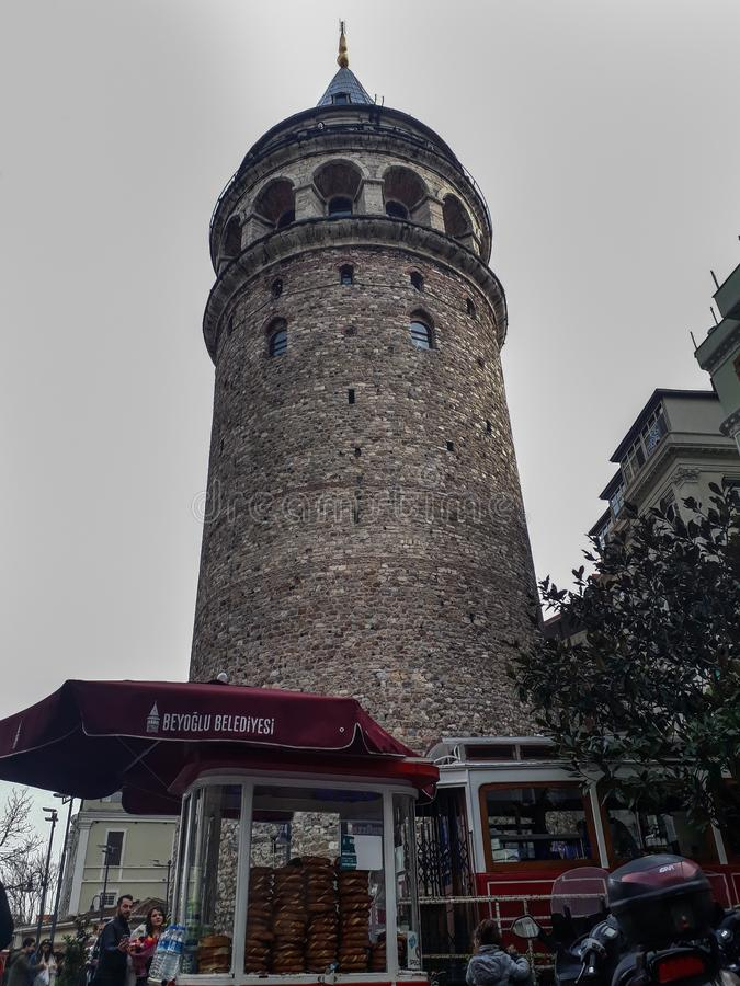 Gatata Tower & Tramcar in Beyoglu Istanbul. Historical Galata Tower & Tramcar & Bagels in Beyoglu Istanbul Turkey royalty free stock photos