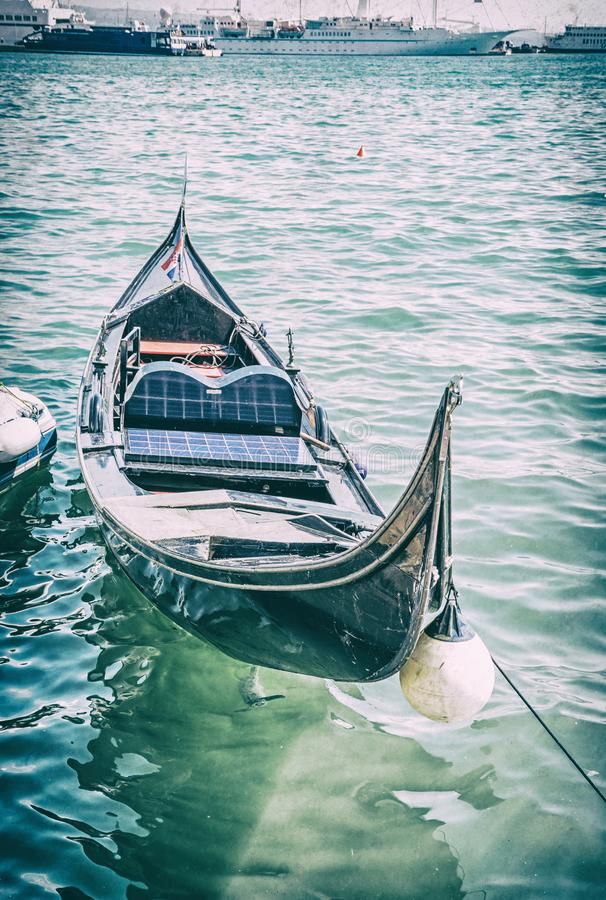 Historical gondola in harbor, Split, analog filter. Historical gondola in harbor, Split, Croatia. Summer vacation. Travel destination. Analog photo filter with royalty free stock photo