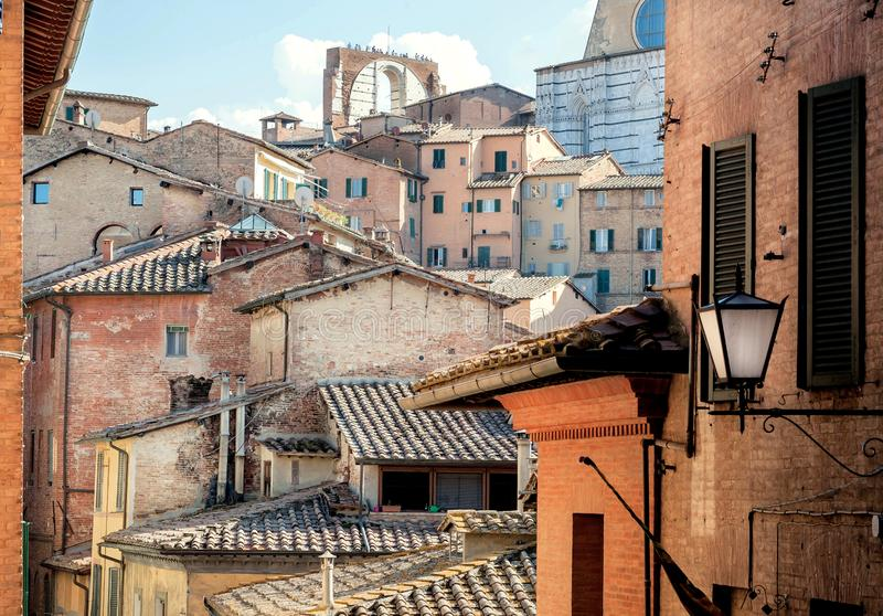 Historical houses of ancient city Siena, Tuscany. Tile roofs and brick structures in Italy. UNESCO World Heritage Site.  royalty free stock photo