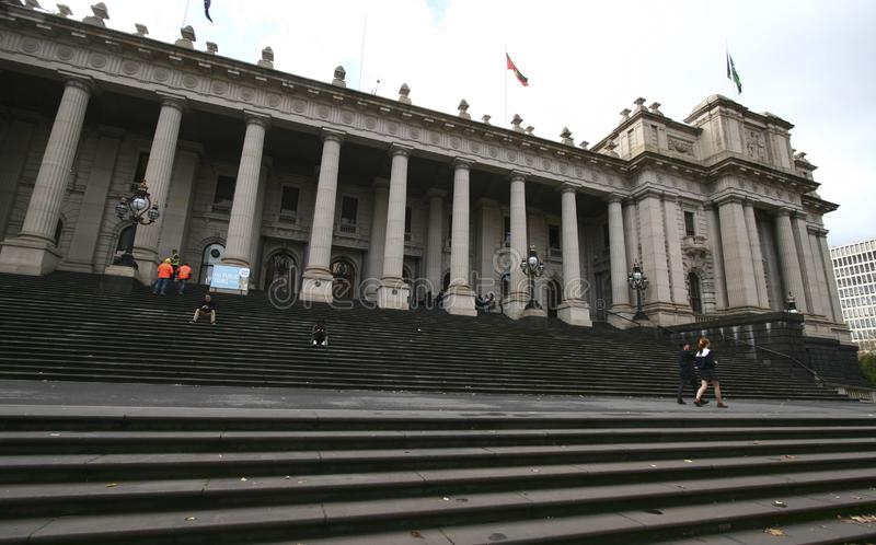 Classic and historic outdoor entrance facade of Parliament of Victoria on grand stairs in Melbourne, Australia stock photos