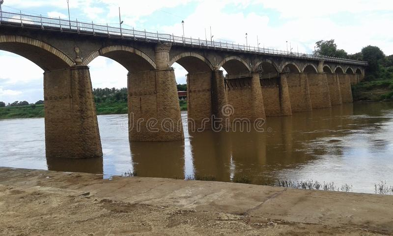 Historical irvin bridge on krishna river ,in sangli city,maharashtra state(india). This bridge is almost 90 years old and still standing firm in sangli(india stock photo