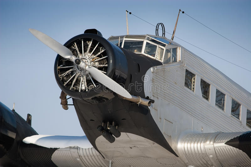 Historical JU 52 aircraft. The Junkers Ju 52 was used as an civilian airliner and military aircraft manufactured between 1932 and 1945 by Junkers corporation. It stock photo