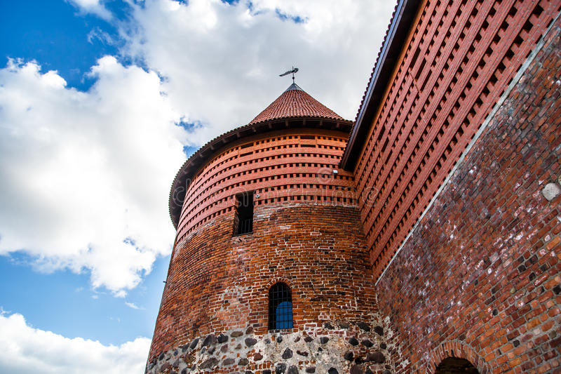 Historical Kaunas Castle. View of high brick walls of historical gothic Kaunas Castle from medieval times in Kaunas, Lithuania, on cloudy sky background royalty free stock image