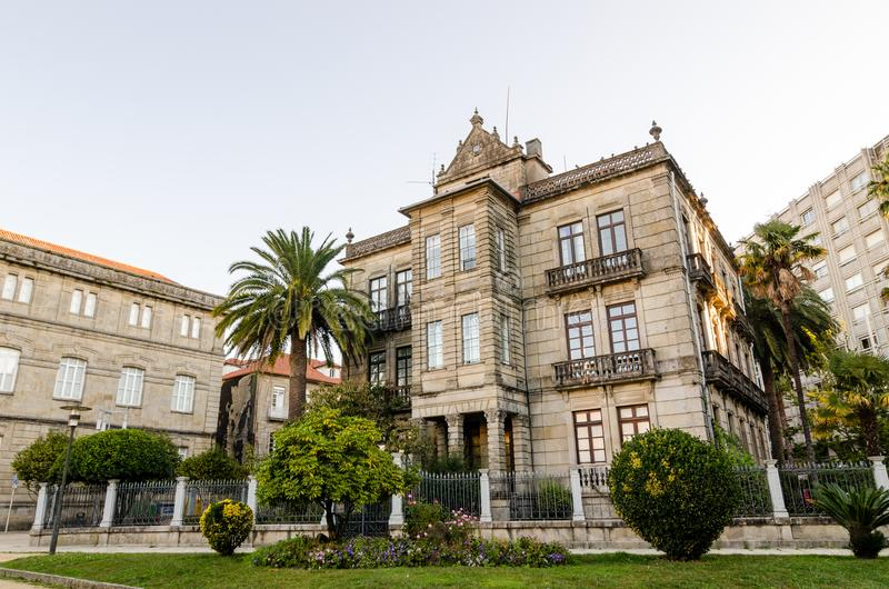 Historical masonry building in Vincenti gardens in Pontevedra Spain. Palms and plants in the entrance.  stock photo