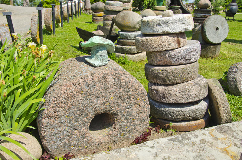 Historical millstone collection in farm royalty free stock photos