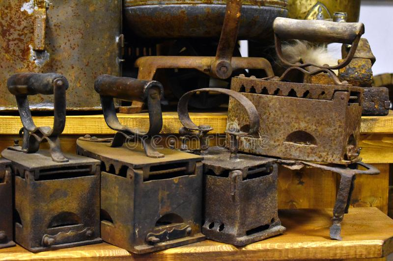 Old pig-iron flat irons. Household house utensils of  past stock images