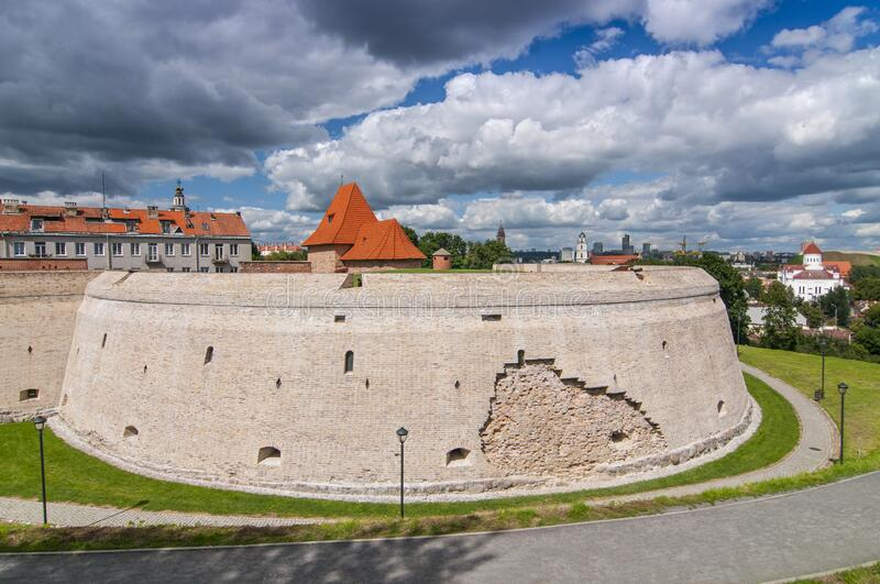 Historical old town street and castle in Vilnius, Lithuania.  stock photos