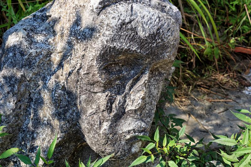 Stone sculpture close-up: the face of an old man. New Athos, Abkhazia. stock photo