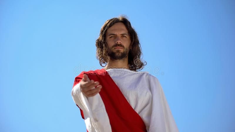 Historical personification of Jesus Christ reaching arm to camera, helping hand. Stock photo royalty free stock image