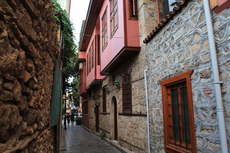 Historical pink homes in the streets of city. Historical pink homes and alley. Clean and securely streets is important for people in the city royalty free stock photography