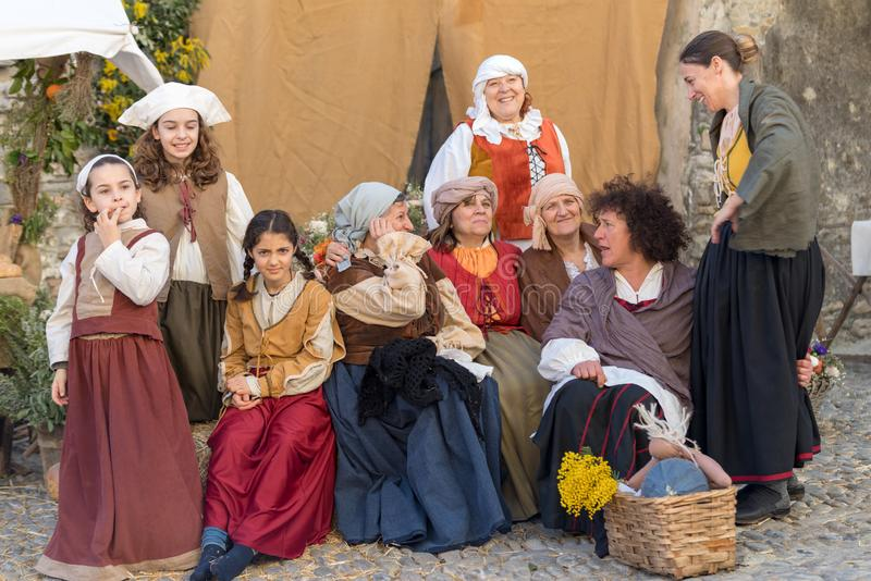 Historical re-enactment participants. Participants of historical reenactment in the old town of Taggia, in Liguria region of Italy. The actors acting out stock image