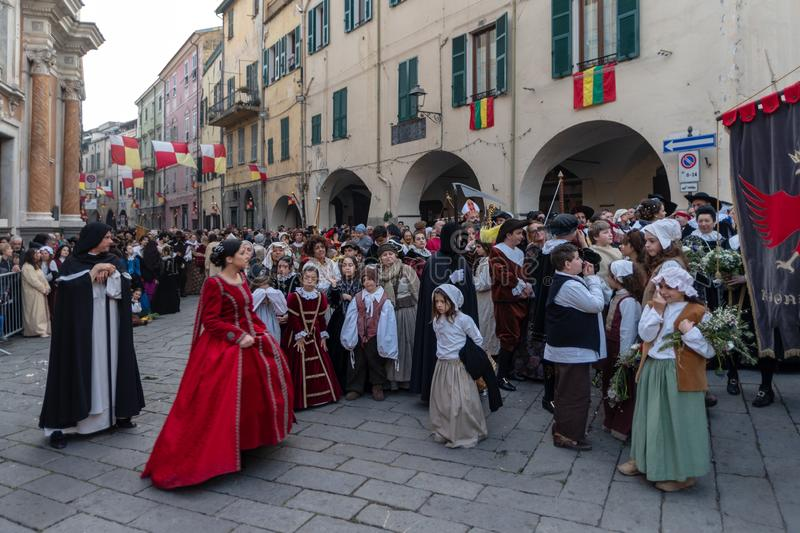 Historical re-enactment participants. Participants of historical reenactment in the old town of Taggia, in Liguria region of Italy. The actors acting out royalty free stock image