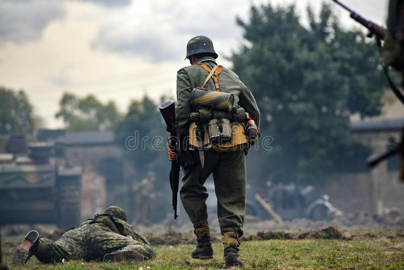 Historical reenactment of soldiers during the Second World War,. View from the back stock photo