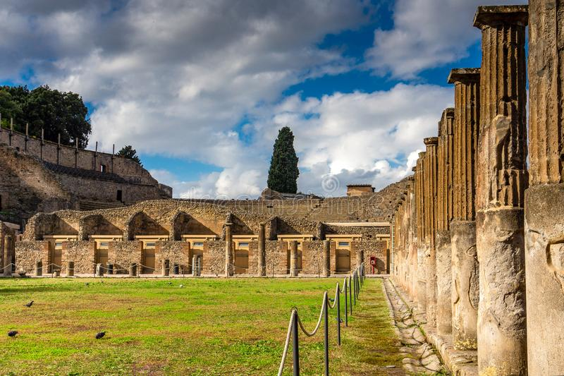 Historical ruined building with the Vesuvius mount, Pompeii. Historical ruined building with the Vesuvius mount, Roman city Pompeii royalty free stock photo