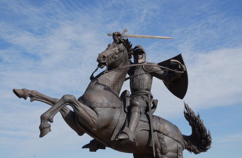 """Historical sculpture ,, Warrior of Freedom """"in Kaunas, Lithuania. Historical sculpture ,, Warrior of Freedom"""" in Kaunas, Lithuania with horse, shield royalty free stock photography"""