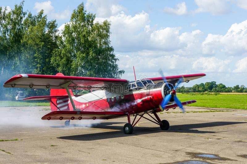 Historical single engine airplane Antonov AN2, starting the engine. Historical mass produced single engine airplane Antonov AN2, starting the engine stock photography