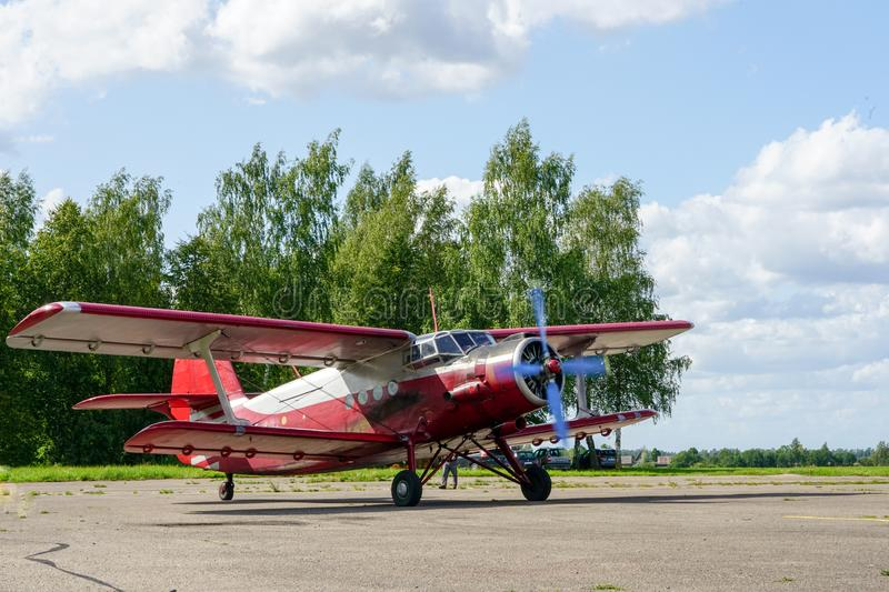 Historical single engine airplane Antonov AN2, starting the engine. Historical mass produced single engine airplane Antonov AN2, starting the engine royalty free stock photo