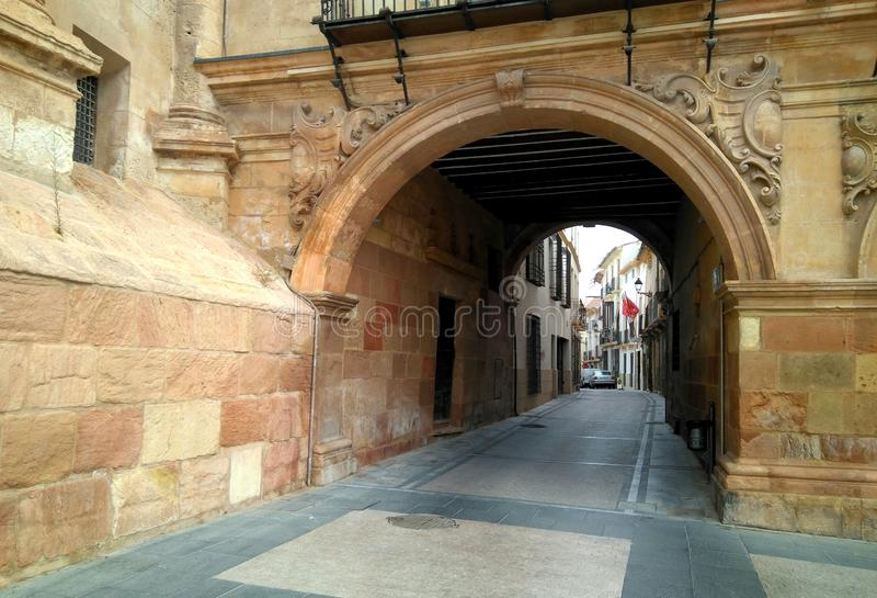 A Historical stone arch in Lorca city, Murcia, Spain. Stone arch for entering toward the Zapateria street in Lorca city, Murcia, Spain stock photos