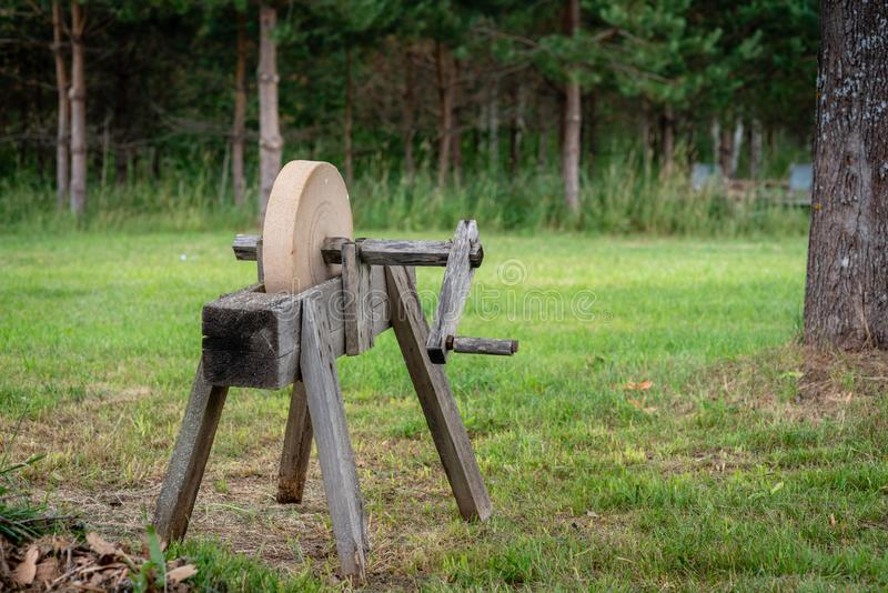 Historical tools. An old, hand-operated, sharpening tool - a grindstone. stock photos