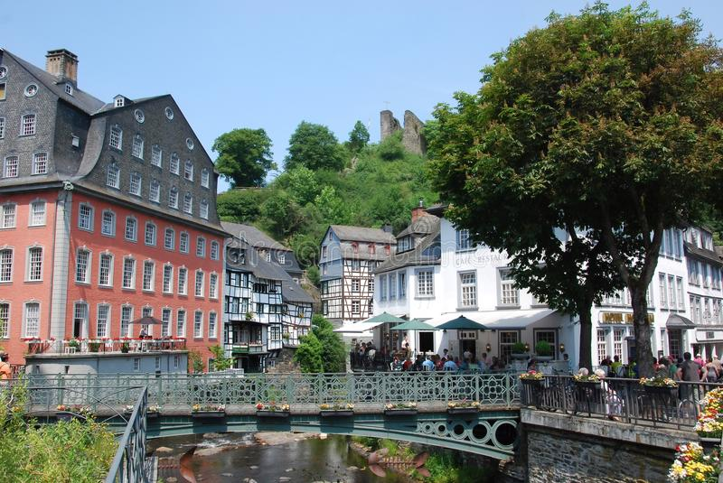 Historical tourist town Monschau with half-timbere. D houses, green bridge over River Rur and terraces - North Rhine-Westphalia -Germany royalty free stock photos