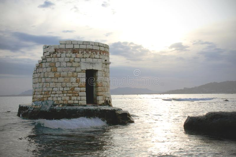 Historical tower building surrounded by sea water. On stormy day, seashore, coast, summer, blue, landscape, tourism, travel, nature, france, vacation stock images