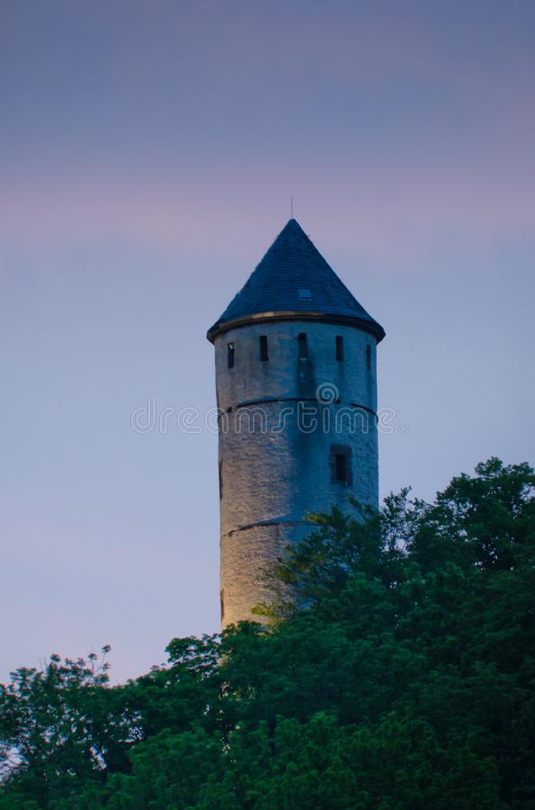 Historical tower in the pastell evening light. This is an old castle with a tower in the smooth evening light. it was built in the middle ages in Göttingen stock image