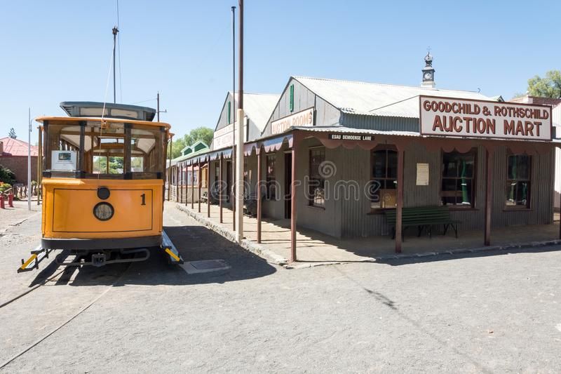 Historical tram and buildings. At museum town at Big Hole stock photos