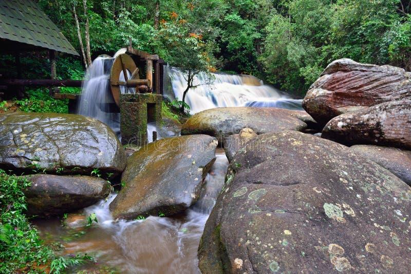 Historical water turbine nears famous museum of political military school. Phu Hin Rong Kla National Park Phetchabun, Thailand royalty free stock image