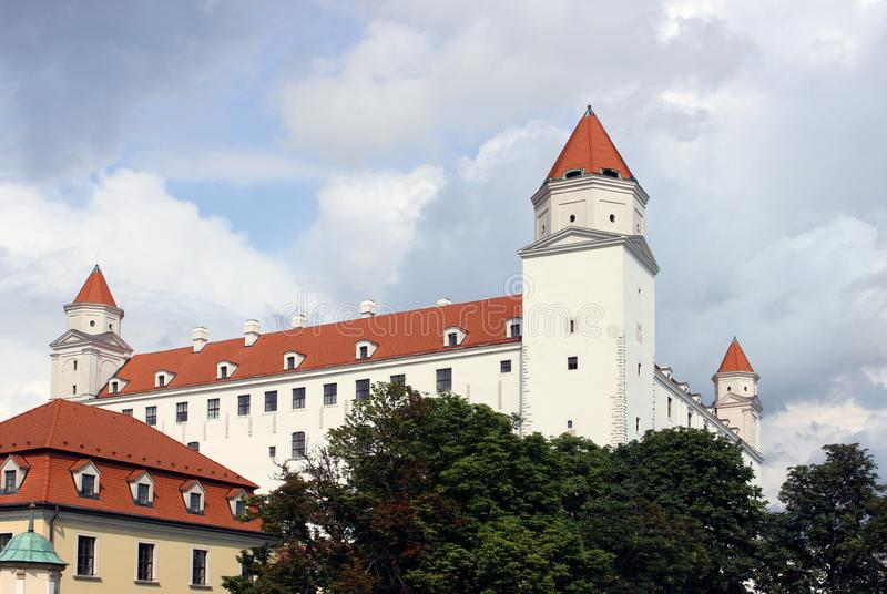 Historical white castle of Bratislava, dominating the capital of Slovakia. Under a blue cloudy sky royalty free stock photos