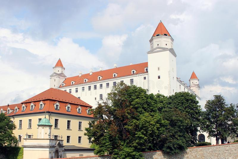Historical white castle of Bratislava, dominating the capital of Slovakia. Under a cloudy sky royalty free stock photo